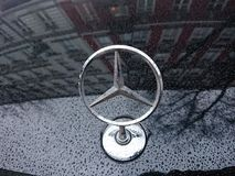 Mercedes Benz logo on car royalty free stock photography