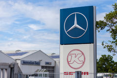 Mercedes-Benz logo near a trucking workshop. BURG / GERMANY - JUNE 11, 2017: Mercedes-Benz logo near a trucking workshop. Mercedes-Benz is a global automobile Royalty Free Stock Photos
