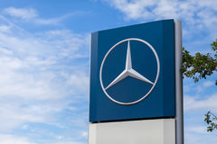 Mercedes-Benz logo near a trucking workshop. BURG / GERMANY - JUNE 11, 2017: Mercedes-Benz logo near a trucking workshop. Mercedes-Benz is a global automobile Stock Photos