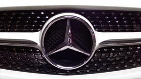 Mercedes Benz logo. In a new sport car Stock Images