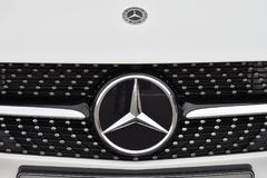 Mercedes-Benz logotype on a car Stock Images