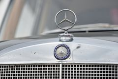 Mercedes-Benz logotype on a car Stock Photos