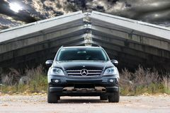 September 18, 2012, Kyiv. Ukraine. Mercedes-Benz ML-Class against the background of a hangar with clouds. Mercedes-Benz ML-Class against the background of a royalty free stock photography