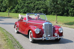 Mercedes Benz Oldtimer. Red Daimler oldtimer in the streets of germany Stock Images