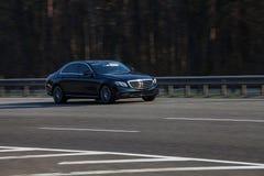 Mercedes Benz S class black speeding on empty highway Royalty Free Stock Image