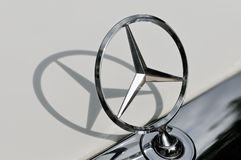 Mercedes Benz sign and its shadow close up Royalty Free Stock Image