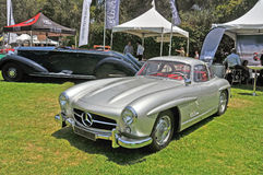 Mercedes-Benz 300SL. Built from 1954 to 1963 this grand touring coupe with its gull wing doors was an instant success. It is powered by a SOHC, fuel injected in Stock Photos