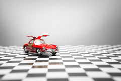 Mercedes Benz 300sl. Izmir, Turkey - June 1, 2015; Product shot of a 1954 Mercedes Benz Toy car on a checked background Stock Photos