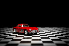 Mercedes Benz 300sl. Izmir, Turkey - June 1, 2015; Product shot of a 1954 Mercedes Benz Toy car on a checked background Royalty Free Stock Image
