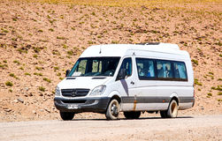 Mercedes-Benz Sprinter. ANTOFAGASTA, CHILE - NOVEMBER 16, 2015: Modern minibus Mercedes-Benz Sprinter at the gravel road Royalty Free Stock Photos