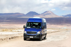 Mercedes-Benz Sprinter. ANTOFAGASTA, CHILE - NOVEMBER 15, 2015: Touristic van Mercedes-Benz Sprinter at the intercity gravel road through the Atacama desert Royalty Free Stock Photo
