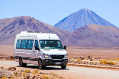 Mercedes-Benz Sprinter. ANTOFAGASTA, CHILE - NOVEMBER 16, 2015: White minibus Mercedes-Benz Sprinter at the background of a volcano Stock Photography