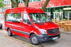 Mercedes-Benz Sprinter. BREMEN, GERMANY - AUGUST 10, 2014: Red passenger van Mercedes-Benz Sprinter at the city street Stock Images