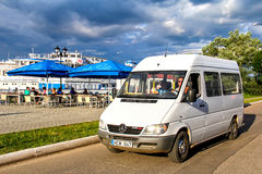 Mercedes-Benz Sprinter 308CDI. PLYOS, RUSSIA - JULY 23, 2014: White passenger van Mercedes-Benz Sprinter 308CDI in the city street Stock Photos