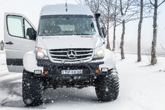 Mercedes-Benz Sprinter Icelandic edition. Reykjavik, Iceland - April 5, 2017: Mercedes-Benz Sprinter off-road Icelandic edition stands on snowy road, front view Royalty Free Stock Image