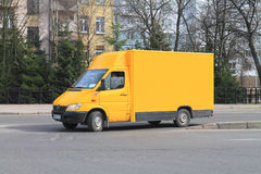 Mercedes-Benz Sprinter. KALININGRAD, RUSSIA - APRIL 2, 2016: A new yellow truck Mercedes-Benz Sprinter on city road Royalty Free Stock Photo