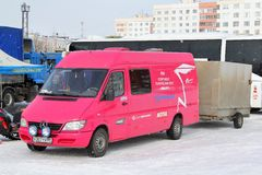 Mercedes-Benz Sprinter. NOVYY URENGOY, RUSSIA - APRIL 12, 2014: Pink Mercedes-Benz Sprinter cargo van at the city street Stock Image