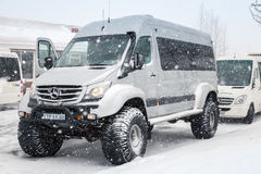 Mercedes-Benz Sprinter off-road model. Reykjavik, Iceland - April 5, 2017: Mercedes-Benz Sprinter off-road Icelandic edition stands on snowy road, close up photo Royalty Free Stock Photos