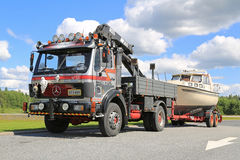 Mercedes-Benz 1622 Truck for Boat Transport. FORSSA, FINLAND - JULY 25, 2015: Customized Mercedes-Benz 1622 rigid truck for boat transport with mobile crane in royalty free stock photos