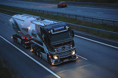 Mercedes Benz Uniq Concept Trucking on Dark Road. PAIMIO, FINLAND - OCTOBER 21, 2016: Mercedes-Benz Actros Uniq Concept, the latest super double tanker truck of Royalty Free Stock Image