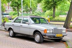 Mercedes-Benz W123 E-class. AMSTERDAM, NETHERLANDS - AUGUST 10, 2014: German retro motor car Mercedes-Benz W123 E-class at the city street Royalty Free Stock Photos