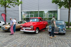 Mercedes-Benz W126 (left), Chevrolet Apache (Task Force) and the Mercedes-Benz W108 (right) Royalty Free Stock Photo