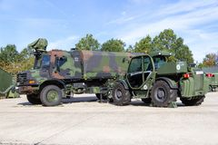 Mercedes Benz Zetros truck and Manitou MHT 950 telescopic handler from german army, stands on platform. MUNSTER / GERMANY - OCTOBER 9, 2017: Mercedes Benz Zetros Royalty Free Stock Photos