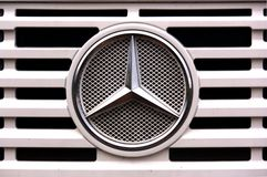 Mercedes car brand logo. 2016. Spain. Close-up of the brand logo of Mercedes cars on a loading truck royalty free stock photos