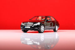 Mercedes e-class. New virsion of mercedes e-class with red background royalty free stock photography