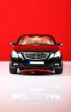 Mercedes e-class. Front view with red background Stock Image