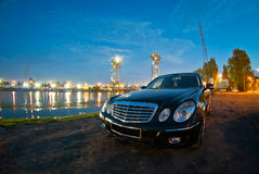 Mercedes E-Class w211. Black Mercedes E-Class w211 at night against the river stock images