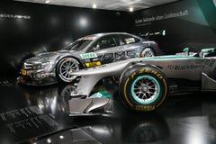 Mercedes F1 W04 y C-cupé de DTM AMG Mercedes Fotografía de archivo libre de regalías