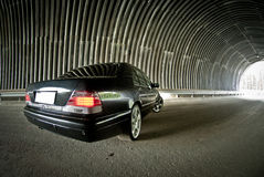 Mercedes goes on light in a tunnel Stock Images