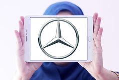 Mercedes logo. Logo of mercedes company on samsung tablet s2 holded by arab muslim woman stock image