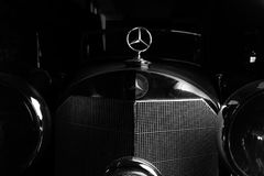 Mercedes logo retro car dark background Adler Trumpf Junior brown luxury retro car Cabrio Limousine dark background. Mercedes logo retro car dark background Royalty Free Stock Images