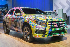 Mercedes med en grafittihud Arkivfoto