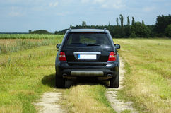 Mercedes ml new. New mercedes ml black colored from the back on a field stock images