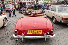 Mercedes 190 SL, front view, retro design car. Exhibition of vintage cars. Rally of old vintage vehicles anciens. Collectors unique cars. Red color with chrome Stock Photography
