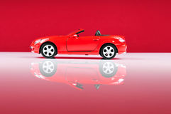 Mercedes SLK 350. Over red background stock photography