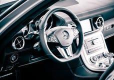 Mercedes SLS Cockpit. Steering wheel, silver, black Stock Photo