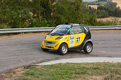 Mercedes Smart in hairpin bend Royalty Free Stock Photography