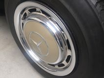 Mercedes tire and wheel. Berlin, Germany - May 13, 2017: Mercedes vintage car tire and wheel. Mercedes Benz is a German global automobile manufacturer known for royalty free stock image
