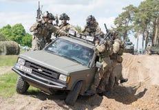 Mercenaires sur le camion Photo libre de droits