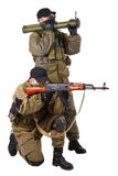 Mercenaries with AK 47 and rocket launcher Stock Images