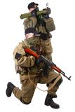 Mercenaries with AK 47 and rocket launcher Stock Photography