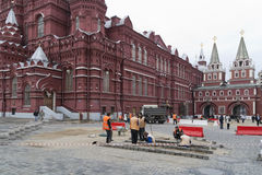 Mercenaries repair a granite  on Red Square Stock Image