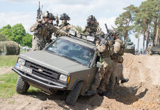 Mercenaries on truck Royalty Free Stock Photo