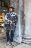 The Mercenary. Venice, Italy-February 18, 2012:Environmental portrait of a person with a six-shooter disguised as an old time western mercenary posing for Stock Photos