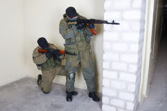 Mercenary with AK rifle. Inside the building Royalty Free Stock Photo