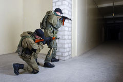 Mercenary with AK rifle. Inside the building Stock Photo